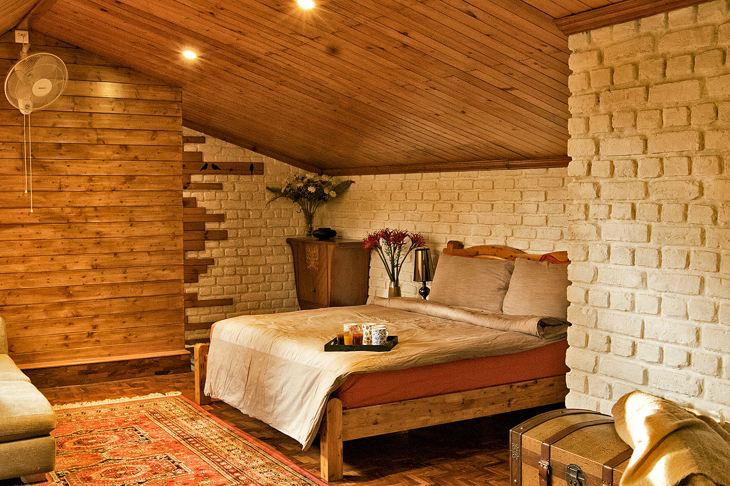 Cozy bedroom with wooden accents and white brick walls